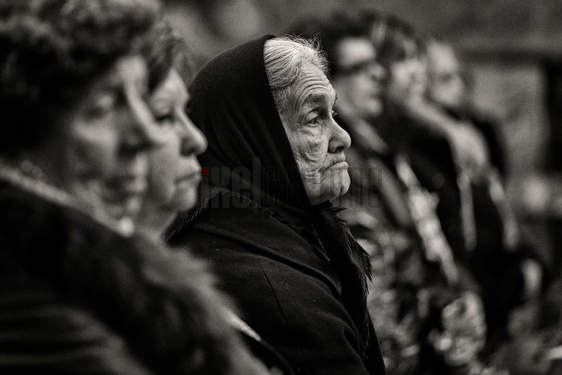 Portrait of a Widowed Woman Attending Mass during Palm Sunday