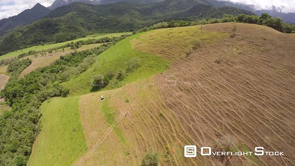 Aerial shot over an area of the Atlantic Forest, showing deforested hillside, Reserva Ecologica de Guapiacu, Rio de Janeiro, ...