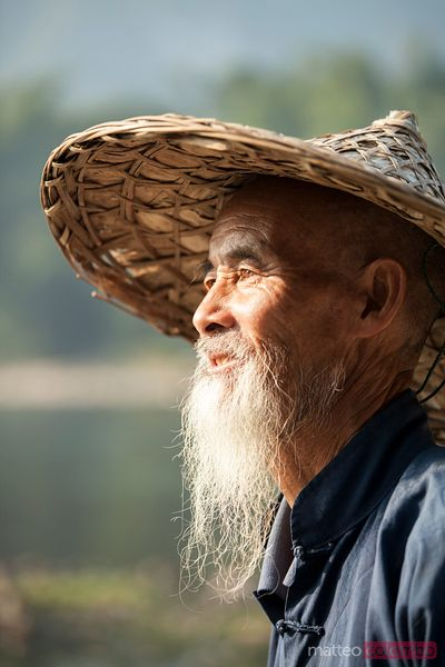 Portrait of old chinese man with conical hat