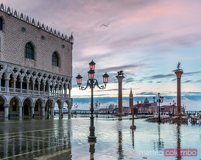 High tide in St Marks square at sunrise, Venice, Italy