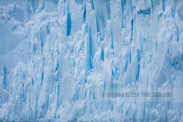Details of ice patterns on the vertical wall of an iceberg in Ilulissat, Greenland