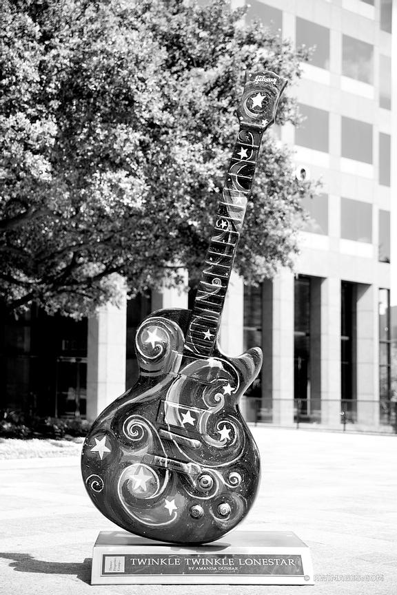 GUITAR SCULPTURE DOWNTOWN AUSTIN TEXAS BLACK AND WHITE VERTICAL