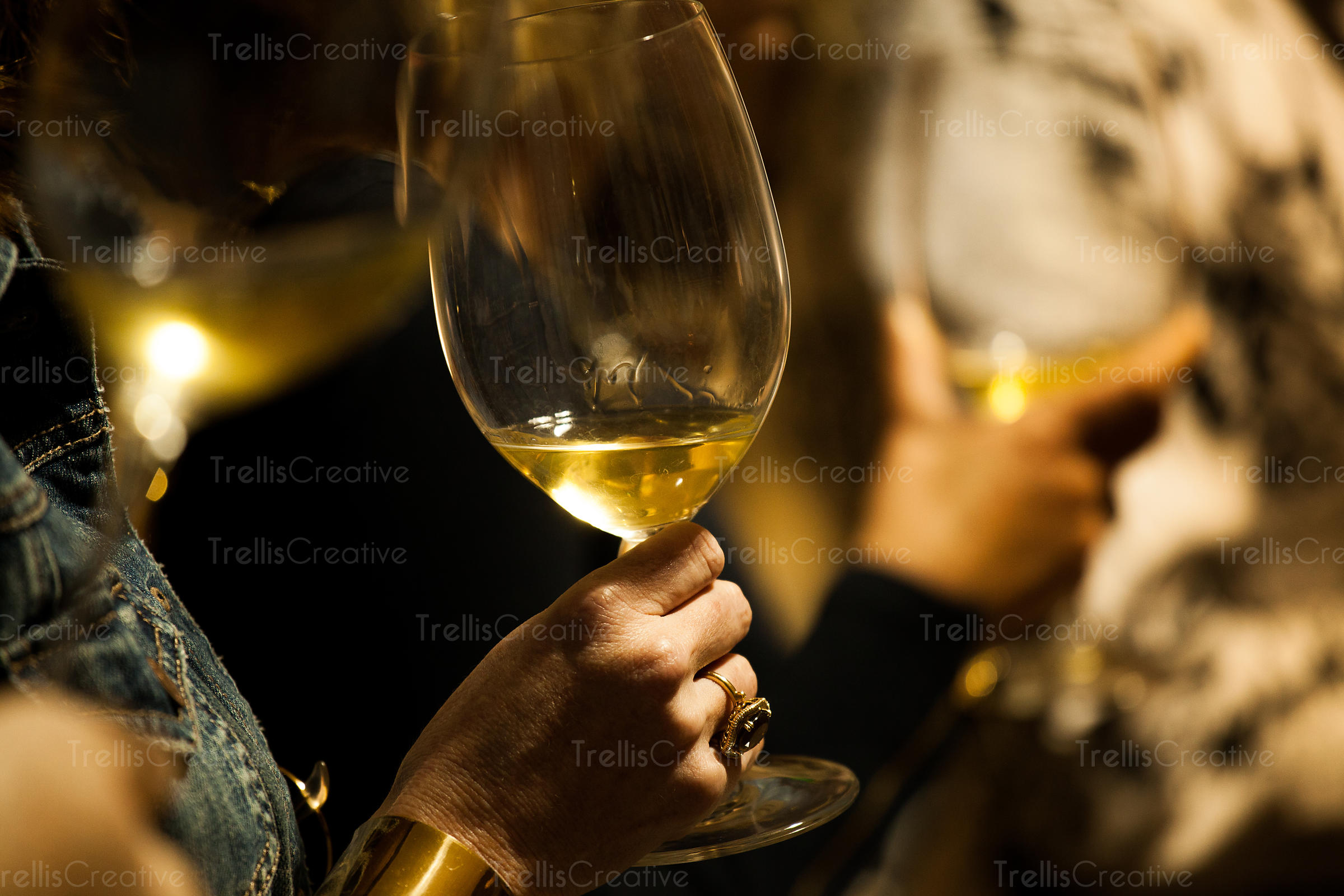 Person drinking white wine at an event