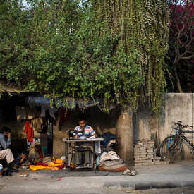 "Kishori Lal, a tailor and his family under an Ashoka tree in New Friends Colony, New Delhi. ""I came from Rajasthan 22 yeas ag..."
