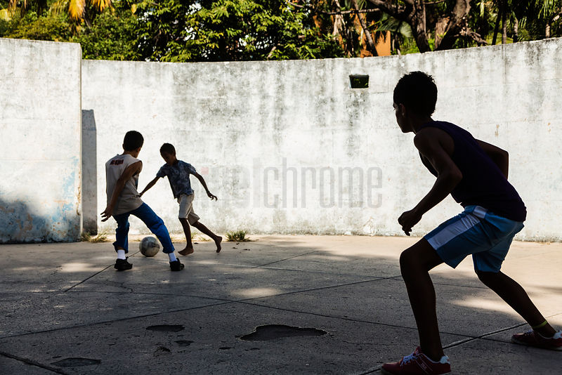 Young Kids Playing Football