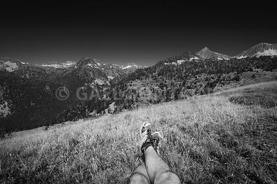 Landscape and legs during mountain hiking at Pyrenean mountain