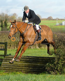 Dave Mee jumping a tiger trap - The Quorn Hunt at Woodpecker Farm