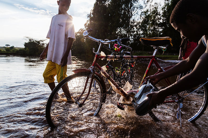 Boys Washing Bicycles in a River
