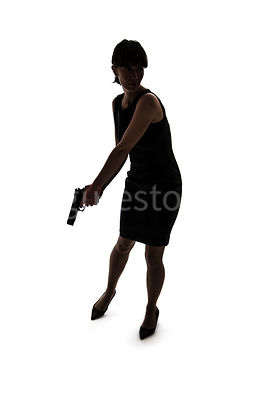 A woman, standing, holding a gun, in silhouette – shot from eye level.