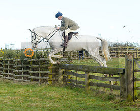 Hector Crouch jumping a hunt jump at Hill Top Farm