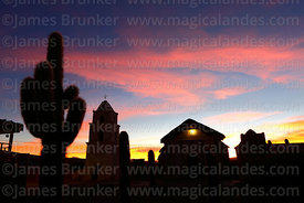 Rustic church, belfry and Echinopsis cactus at sunset, Cariquima, Region I, Chile