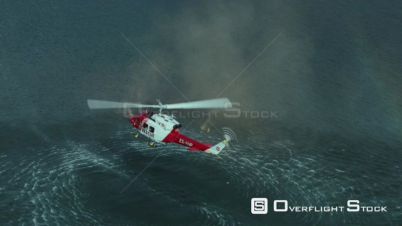 Aerial of a rescue helicopter hovering above the ocean Cape Town Western Cape South Africa