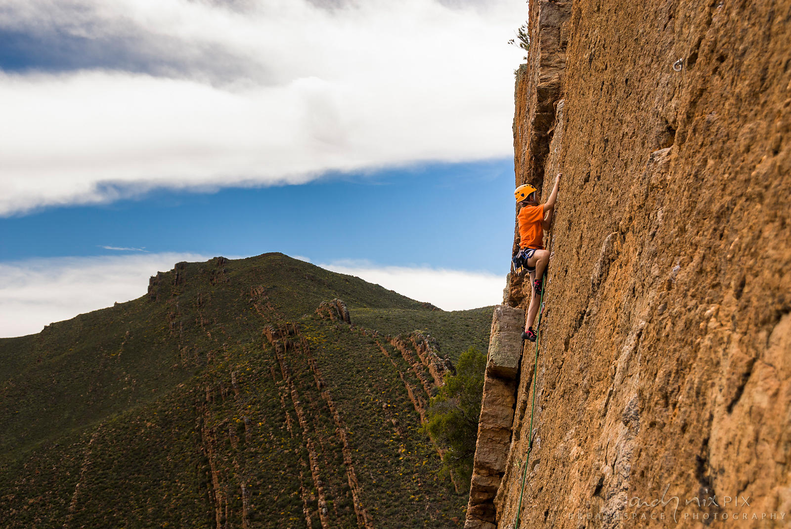 Rock climbers on cliff face