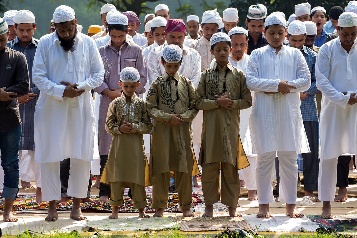 Muslim boys praying during Eid al-Adha, Red Road, Madian, Kolkata, India. I have the only photos taken by a foreigner of this...