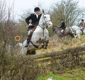 Willie Reardon jumping the hunt jump at Newbold - The Fitzwilliam Hunt visit the Cottesmore at Burrough House