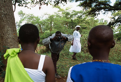 Rwanda - Kibileze - Photographer Leonard Hakizayezu (45), who is HIV positive, takes pictures at a wedding