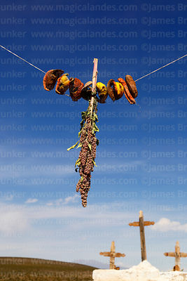 Fruit and quinoa offerings for Carnival hanging in main entrance of Santo Tomás church, Isluga village, Isluga National Park,...