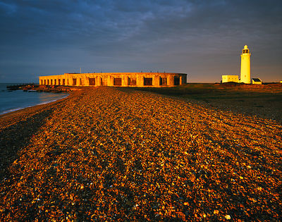 First sunlight on a winter dawn illuminating Hurst Castle and lighthouse.