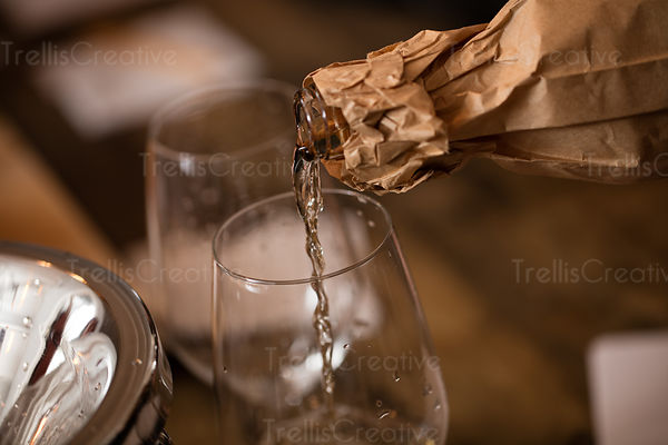 Close-up of a white wine poured into wine glass