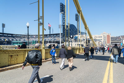 Pedestrians Cross Clemente Bridge in Pittsburgh, PA