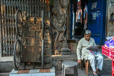 A Man Reads His Morning Newspaper Outside An Old Haveli In Sitaram Bazar,