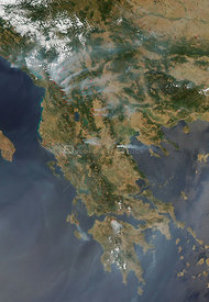 EARTH Greece -- 25 Jul 2007 -- This satellie image shows extensive forest fires on the Balkan Peninsula, mostly in Greece,
