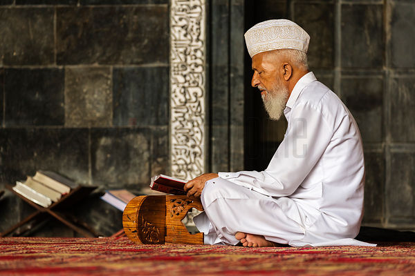 Portrait of a Man Praying at the Jama Masjid
