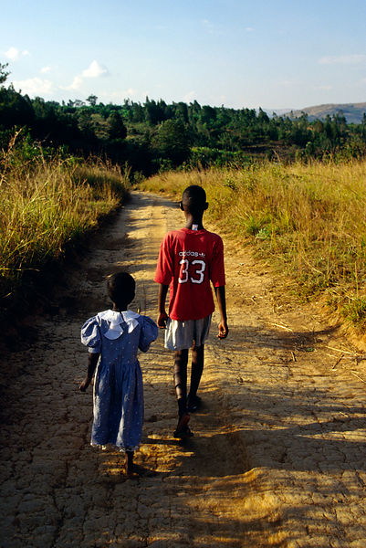 Burundi - Ruyigi - Two war orphan children walking back to their home