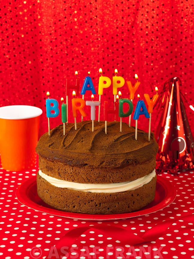 Chocolate cake with happy birthday candles