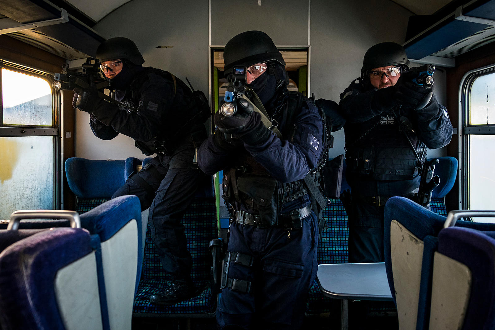 British Police Firearms Training. Storming a Train.