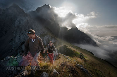 Austria, Salzburg, Filzmoos, Couple hiking on mountains