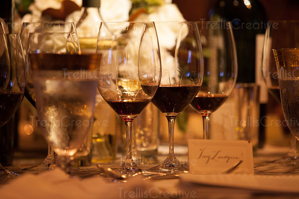 An elegant party table with many glasses of fine red wine