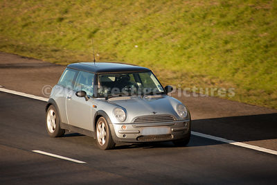 Silver Mini Cooper Driving on Motorway