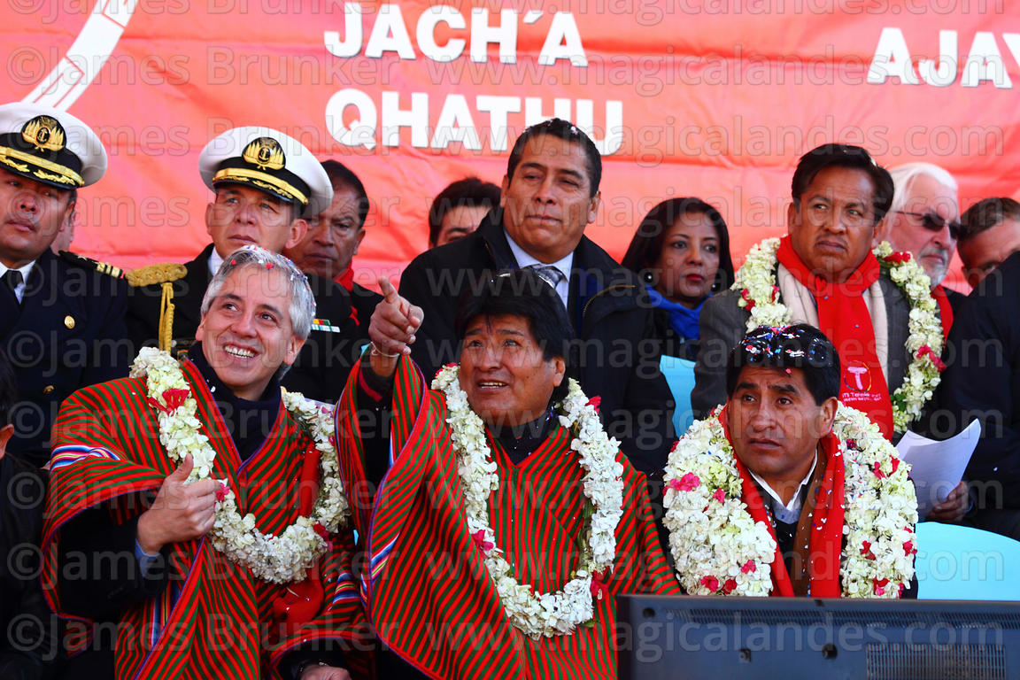 Bolivian president Evo Morales (centre) gestures towards the cable car cabins with vice president Alvaro Garcia Linera (left)...