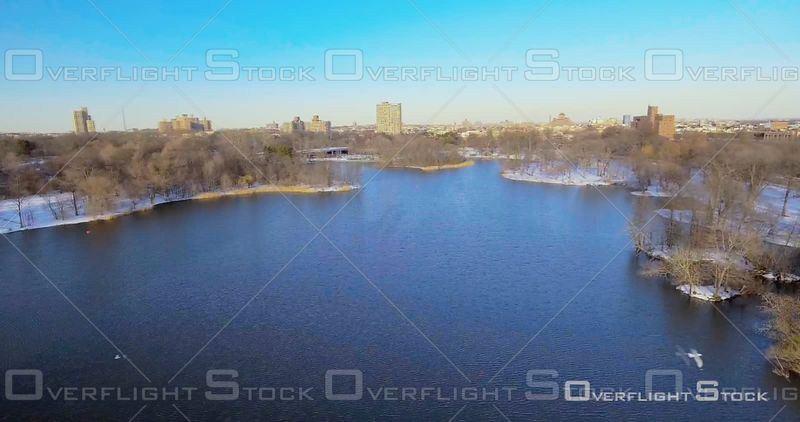 Aerial Over Snow on Prospect Park Lake Pond Winter Day Birds Flying  NYC