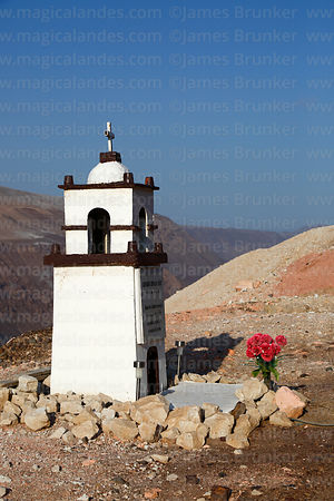 Roadside shrine (called animita de carretera in Chile) to traffic accident victim in form of a church tower next to Ruta 5 hi...