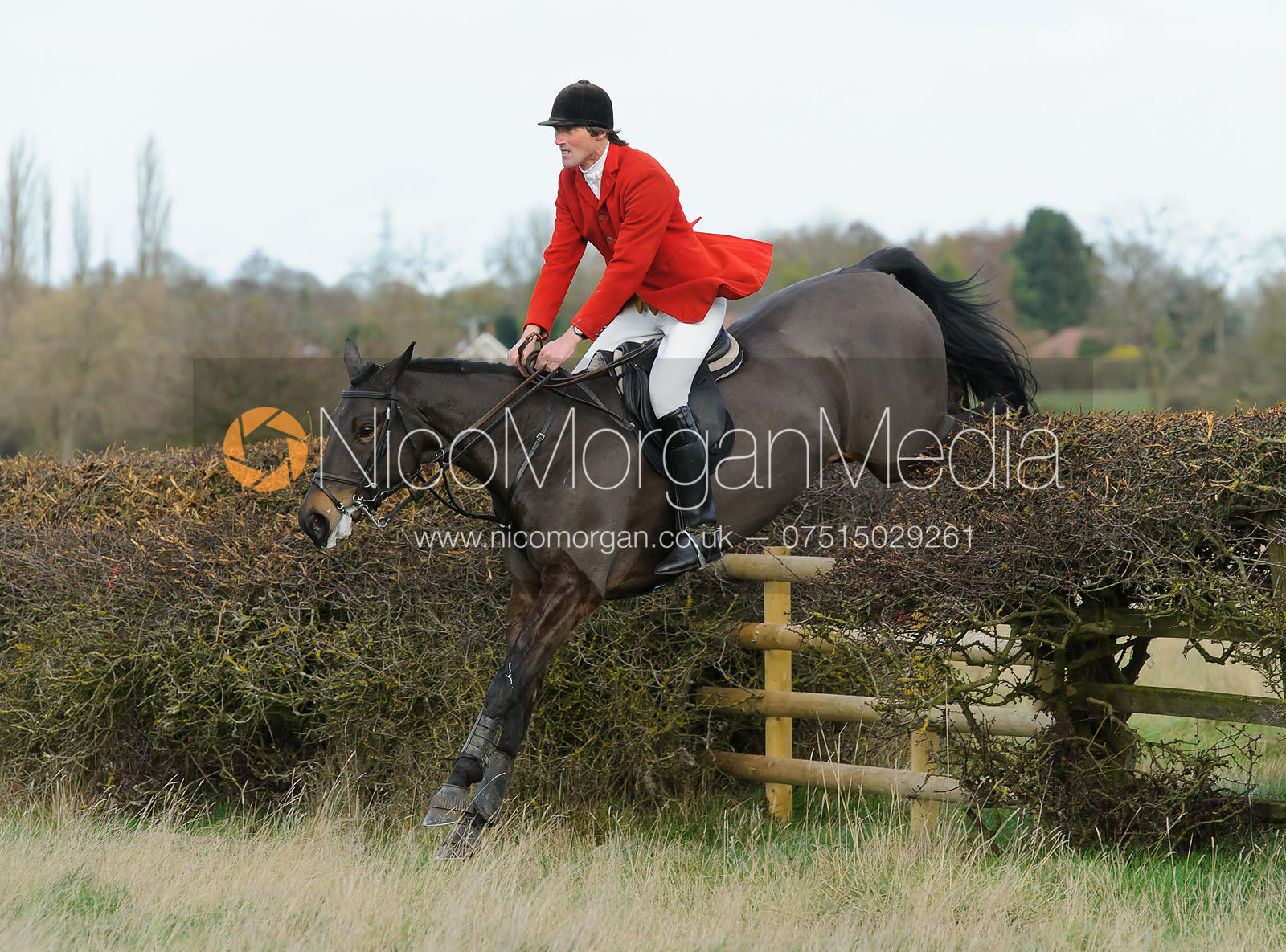 Vere Phillipps jumping a fence