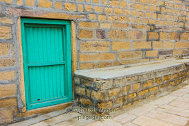 Green Door in Golden Building, near Gadisar Lake, Jaisalmer, India