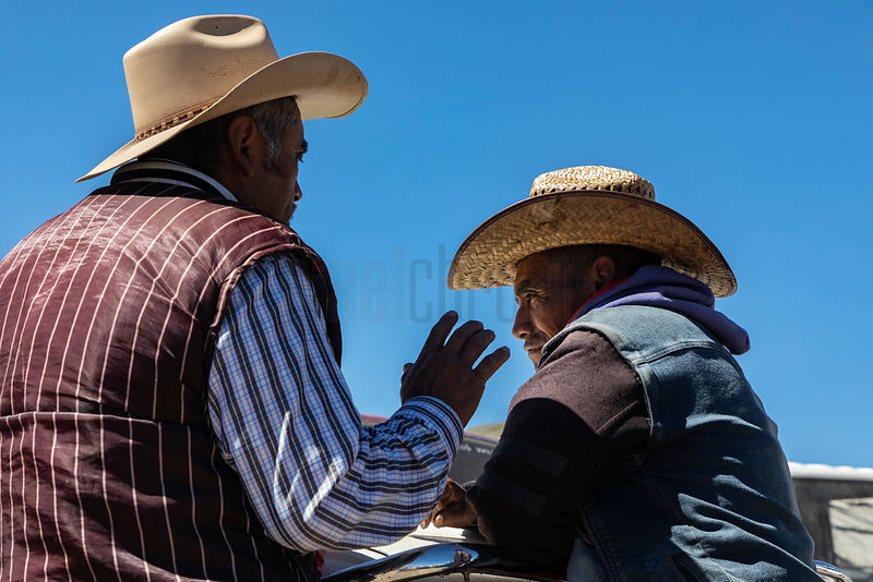 Two Men Having a Conversation at the San Nicolás Market