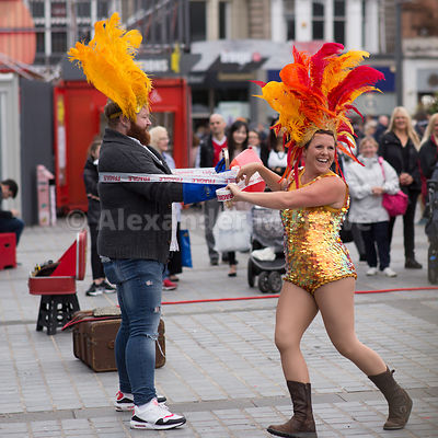 Comic street performer Able Mabel performing with a member of the public in Edinburgh at Festival time - Stock photo entertainer