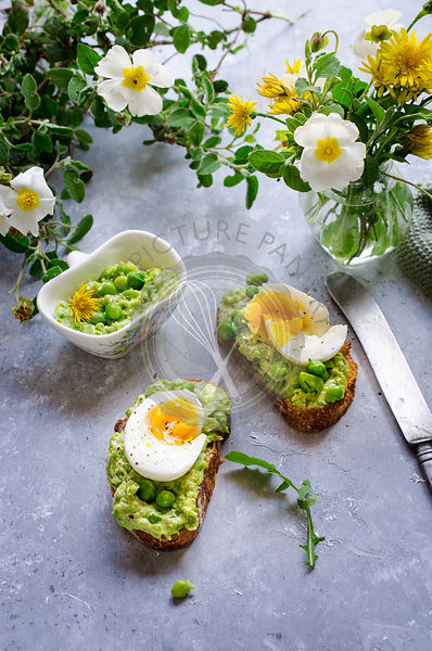 Bruschette with pea and dandelion hummus served with boiled eggs