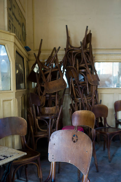 Egypt - Cairo - Stacked chairs in Al Hurriya, a cafe bar once popular with Leftist activists