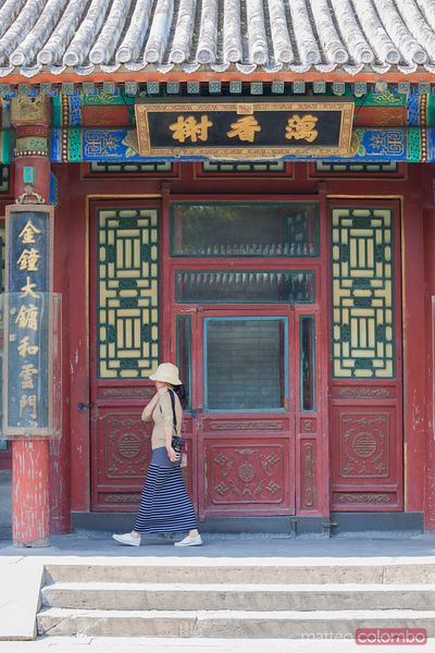 Woman walking in the summer palace, Beijing