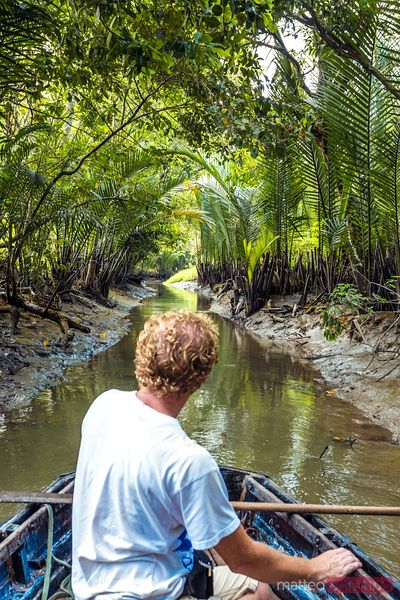 Tourist on a boat in the vietnamese jungle in the Mekong Delta