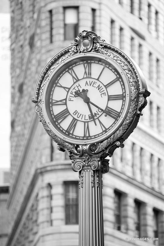 FIFTH AVENUE BUILDING GILDED STREET CLOCK NEW YORK CITY NEW YORK BLACK AND WHITE VERTICAL