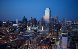 Aerial photograph of the Dallas Texas skyline in the early evening.