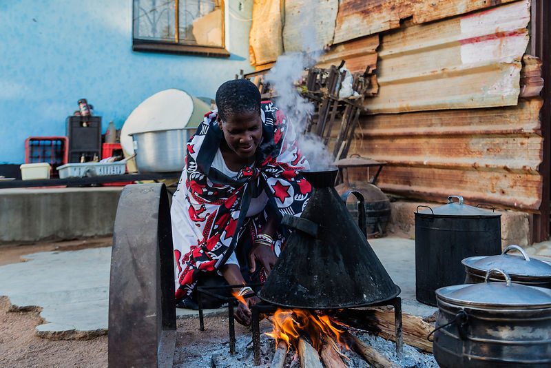Portrait of a Sangoma Preparing a Fire
