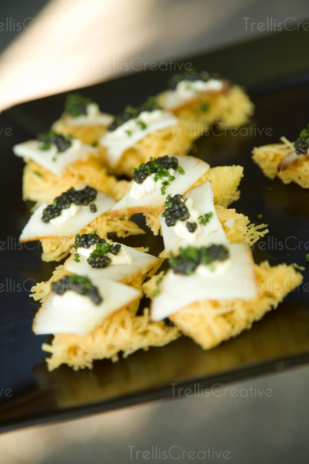 A platter of fried appetizers with caviar