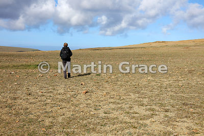 Keen of Hamar National Nature Reserve with a human figure to provide scale, Unst, Shetland