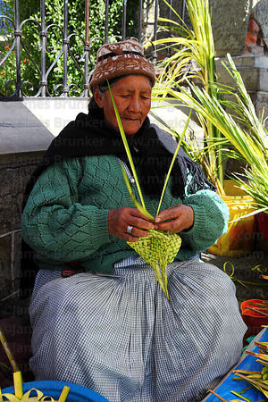 Old lady making ornaments out of palm leaves on Palm Sunday , La Paz , Bolivia